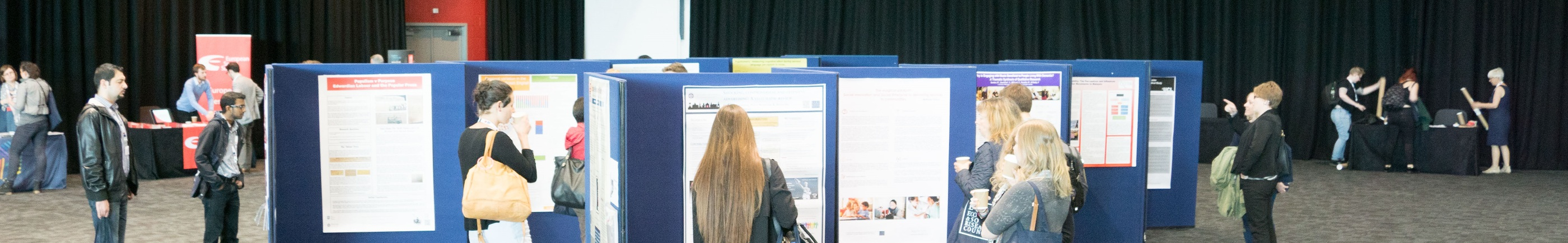 students looking at exhibition of posters